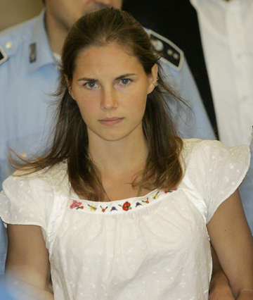 Amanda Knox is escorted by Italian police officers from Perugia's court in central Italy in 2008. She was convicted of killing her roomate but the conviction was overturned on appeal and she now faces a retrail.