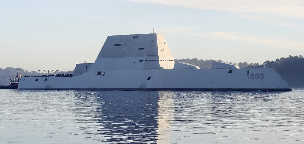 Gordon Chibroski/Staff Photographer The Zumwalt launches from Bath Iron Works and heads down the Kennebec River for sea trials.