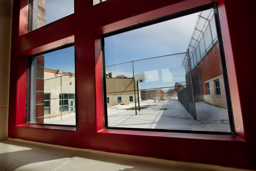 A hallway window at the Long Creek Youth Development Center looks out on a fenced-in activity yard at the South Portland facility. Questions are being raised after a suicide there in October.