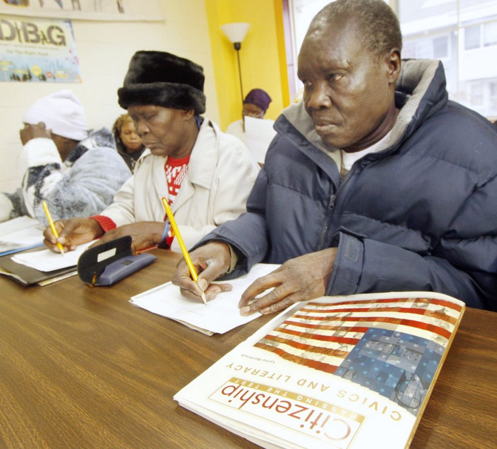 Peter Aboda and other Sudanese refugees and immigrants take a civics class in Maine in 2011, when there was more resettling.