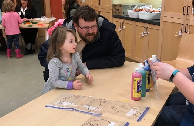 Guy Meader and his daughter Addie attend Literacy for ME's Augusta team-sponsored annual Pre-School Family Fun Night at Lithgow Public Library in Augusta.